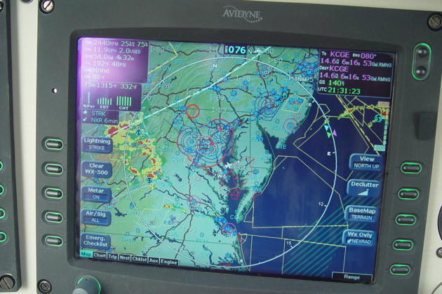 In-flight to Cambridge-Dorchester airport, MD (KCGE) in Gil Rud's Cirrus SR-20. Storms approaching from the west!