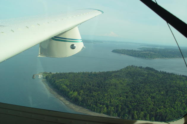 Cruising over Blake Island, west of Seattle over the Puget Sound.