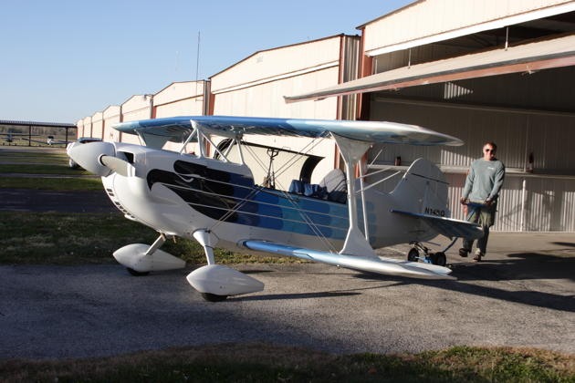 Bill Sommer maneuvering his Christen Eagle II out of his hangar at Creve Coeur airport.