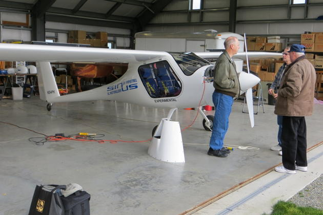 Pre-flighting Sinus N54PK with Paul Kuntz in his hangar at Sequim Valley airport. Photo by Jim Bettcher.
