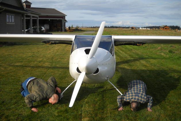 Kissing the ground (in jest) after a successful first flight! Photo by Dan Masys.