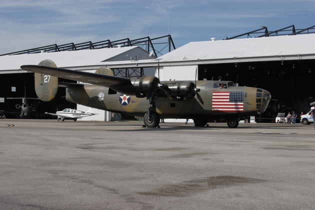 B-24 Diamond Lil parked in front the combined B-29/B-24 hangar.