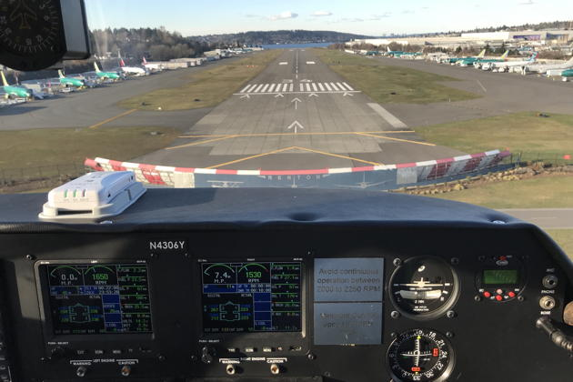 On short final to Renton's runway 34 in George Johnson's Apache.