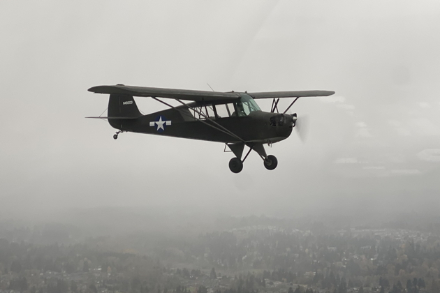 Dan Barry snug on our wing in his Aeronca L-3 in poor weather.