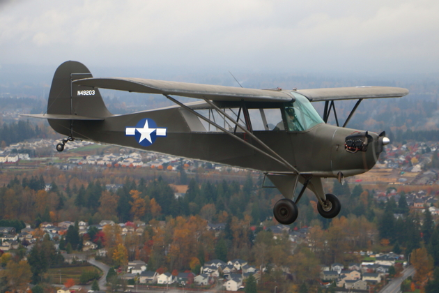 Dan Barry in his Aeronca L-3 in close formation as the weather slightly cleared.