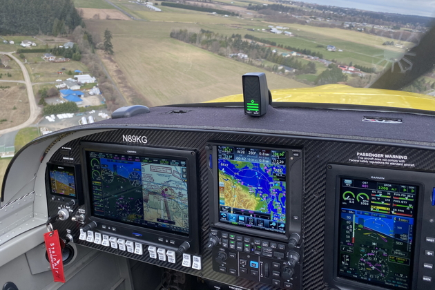 A nice view of the RV-14's all-Garmin panel, while turning final for runway 27 at Sequim Valley (W28).
