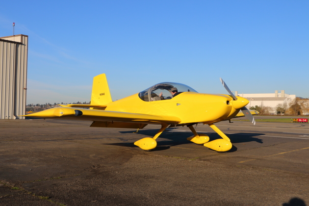 Dave Miller ready to start his RV-14A at Renton. Notice the impressive headroom available.